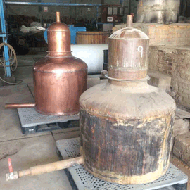 A peak into the distillery. A brand new copper distiller has arrived to replace the old worn one.